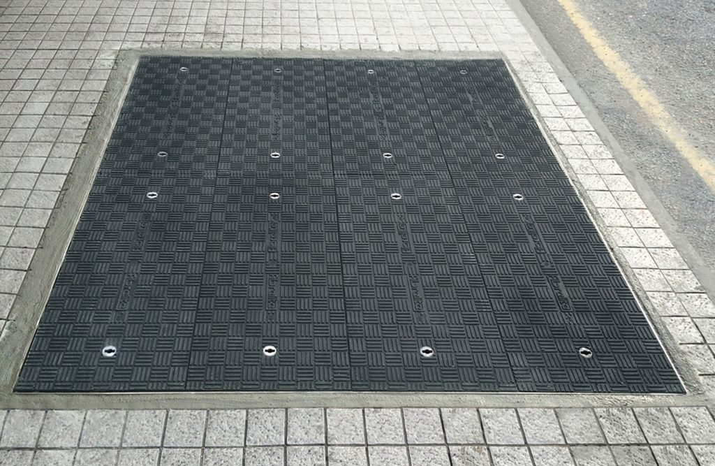 Lightweight GRP composite trench covers