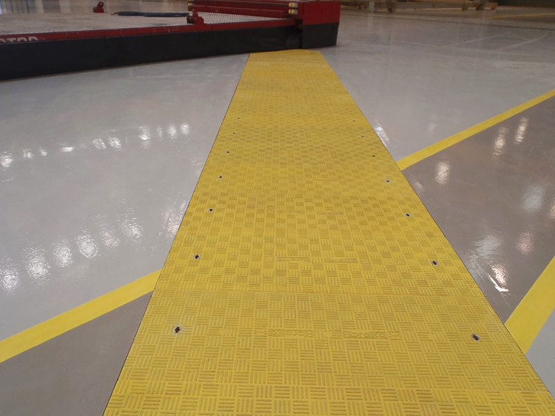 The Fibrelite yellow C250 (25 tonne) load rated standard duty trench access covers.