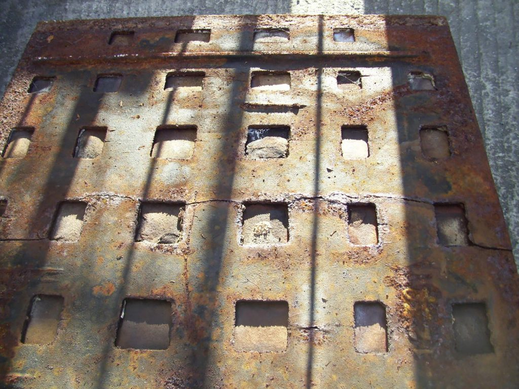 The previously installed old corroding and crumbling concrete covers