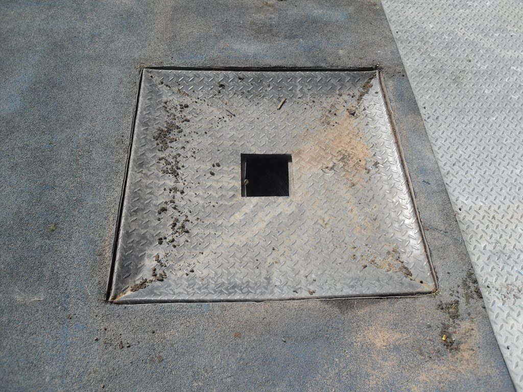 Out with the old: the damaged reinforced steel cover to be replaced by Fibrelite's trench covers
