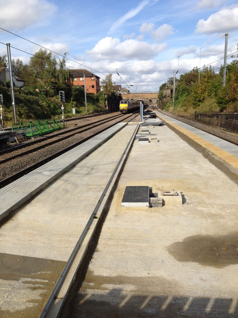Section of train station platform with 4 covers (mid-way through install)