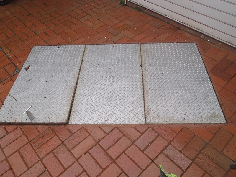 Previously installed odour-emitting galvanised covers