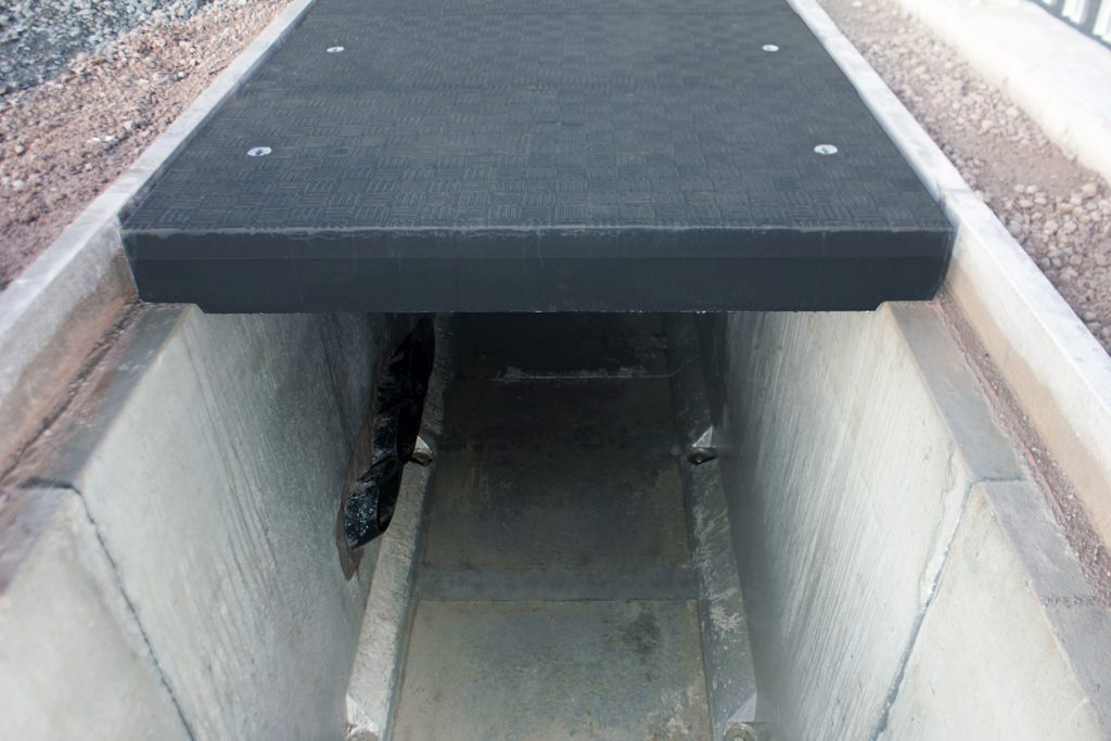 Covers 'stepped' to reduce weight and fit trench width