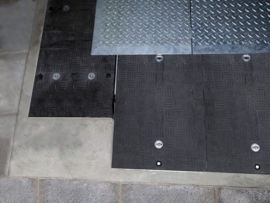 Securing system moulded into covers which locks into frame, preventing unauthorised access