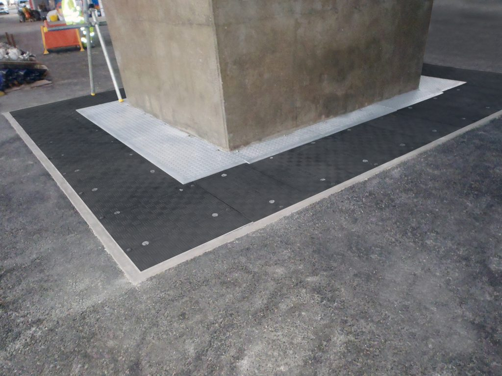 Replacement bearings located in the underground pits, covered by continuous set of access covers, allowing for the minor movement of the pier