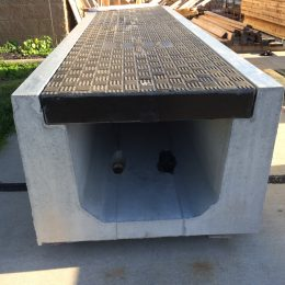 Custom moulded composite trench covers engineered to fit Trenwa's precast trench systems