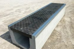 Precast concrete trench systems including Fibrelite covers