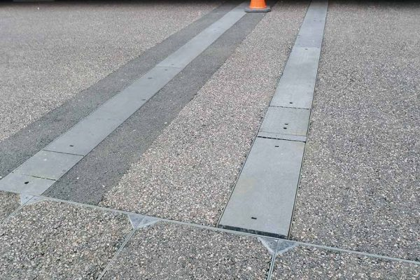 Previously installed covers were unable to withstand heavy loads causing them to crack and deform