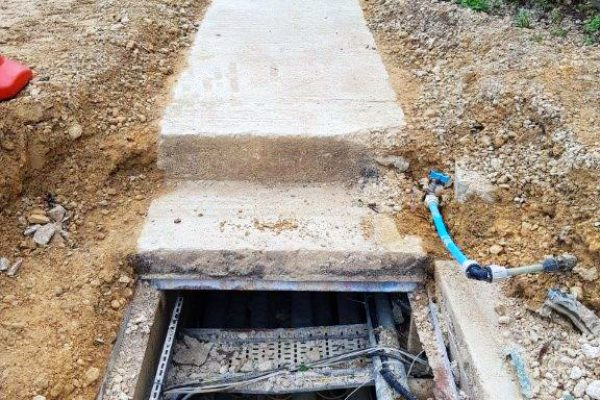 Concrete covers posed a risk of injury to maintenance workers due to their weight
