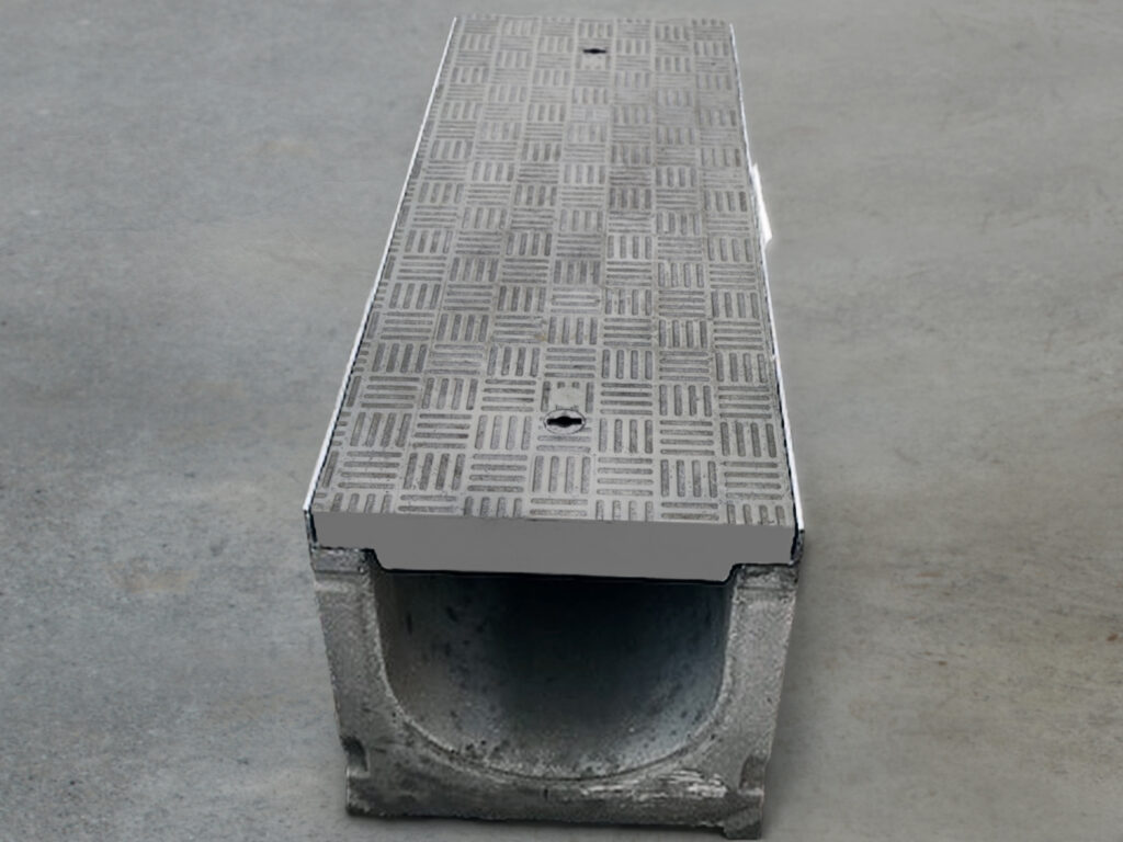 Covers were stepped from 40 to 65mm deep to meet E600 load rating