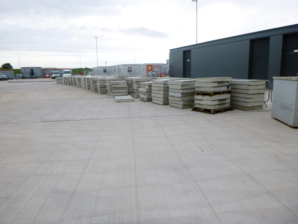 Previously existing concrete covers stacked, awaiting disposal